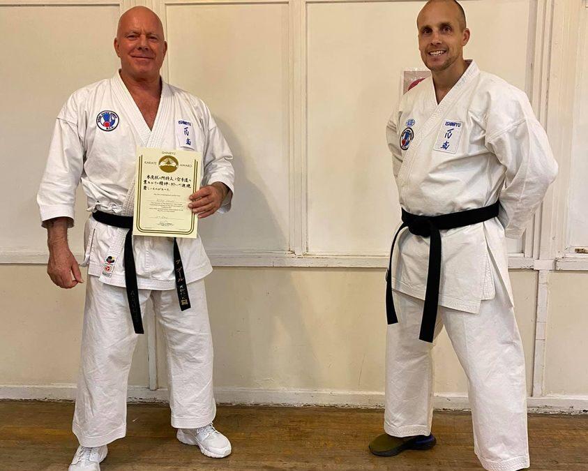 Sensei Alan Poole receives 5th Dan award from Sensei Lee Smith